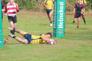 Beecham crosses the line for the first Raider try