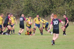 Captain Fogerty fends off another defender