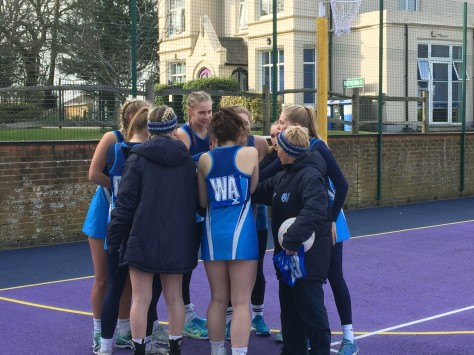 Netball Sussex Cup final huddle
